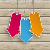 3 Colored Price Stickers Arrows Wood. Infographic with colored price stickers arrow on the wooden background Stock Photos