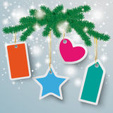 Colored Price Stickers Snow Lights Fir Branch. Snow with star and red ribbon on the grey background Stock Photo
