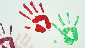 Colored prints of children and adults palms on white background. stock photography