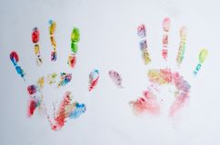 Colored prints of hands on a white background. Popular photo Stock Illustration