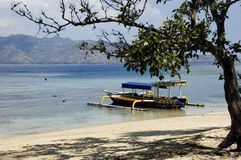 Colored pump boat and view of Lombok island. From Gili Air, Indonesia Stock Photo