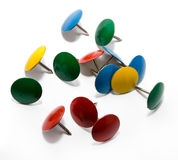 COLORED PUSH PINS. Isolated on a white Stock Images