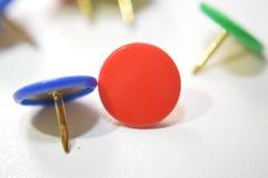Colored push pins metal tacks stock photo
