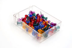 Colored push pins in a plastic box Stock Image
