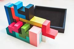 Colored puzzle in black box Stock Photography