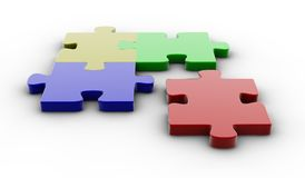 Colored puzzle pieces. Four colored puzzle pieces isolated on white Royalty Free Stock Images