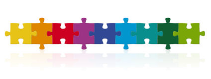 Colored puzzle pieces in series. Multi colored puzzle pieces in series Royalty Free Stock Image