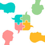 Colored puzzle speech bubbles and people heads Royalty Free Stock Images