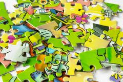 Colored puzzles closeup. children`s play puzzles. Game for the development of the child royalty free stock photo