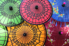 Colored Red, Green and Yellow Burmese Umbrellas Stock Images