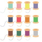 Colored reels of thread on white background Royalty Free Stock Photos