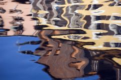 Colored reflections of buildings in water. Stains and colored reflections of buildings in water Royalty Free Stock Photo