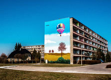 Colored residential building. Schwedt/Oder, Germany - March 10, 2014: A colorful mural on a residential building.It draws attention colorful flying balloon Stock Photo