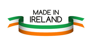 Colored ribbon with the Irish tricolor, Made in Ireland Royalty Free Stock Photos