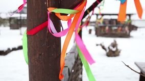 Colored ribbons adorn the wooden pavilions in the winter holiday, Christmas decoration.  stock video
