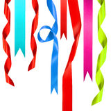 Colored ribbons hanging on white Stock Photography