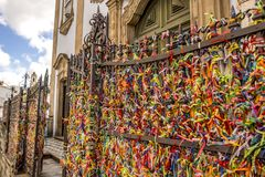 Colored ribbons tied at church entrance in Bahia, Brazil stock photo