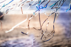 .Colored ribbons in the wind. Beach and ribbons fluttering in the wind Stock Photo