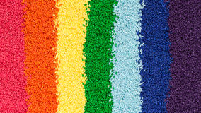 Colored rice for the development of fine motor skills stock photo