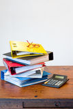 Colored ring binders, glasses & calculator Royalty Free Stock Photos