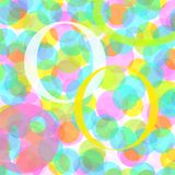Colored rings. On bubbled background Royalty Free Stock Photography