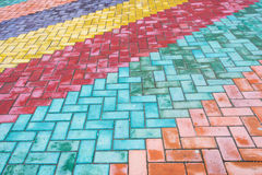 Colored road tiles. Background of colored granite road tiles stock photos