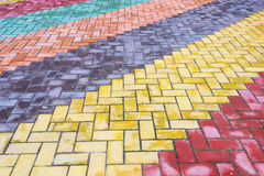 Colored road tiles. Background of colored granite road tiles stock images