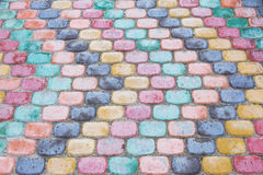 Colored road tiles. Background of colored granite road tiles stock image