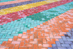 Colored road tiles. Background of colored granite road tiles stock photo