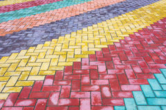 Colored road tiles. Background of colored granite road tiles royalty free stock photos