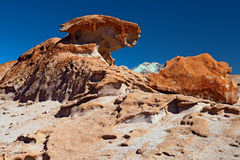 Colored rock formation formed by wind erosion stock images