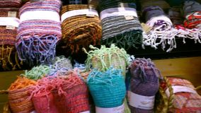 The colored rolled scarves in rows at market. The colored rolled scarves in rows in market. Video shift in motion. macro stock video footage