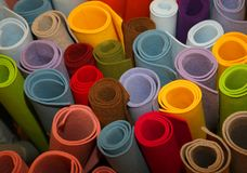 Colored rolls of fabric in the store. Many colored rolls of fabric in the store Royalty Free Stock Image