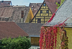 Colored roofs of houses. In the small village Stock Images