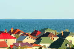 Colored roofs at the seashore Stock Image