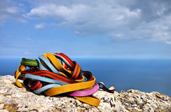 Colored ropes on the rock Stock Photos