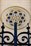 Colored rose window and a iron grate Stock Images