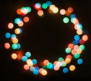 Colored rounded bokeh on dark background, wreath, copyspace, new year background. Colored rounded bokeh on dark background, ring, copy space, new year and stock photography