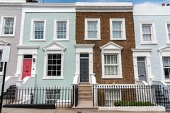 Colored row houses. Seen in Notting Hill, London stock images