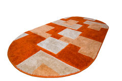 Colored rug. With orange and white royalty free stock photos