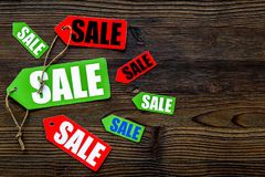 Colored sale labels on dark wooden background top view copyspace Royalty Free Stock Photography