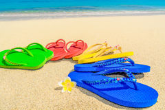 Colored sandals at the beach Stock Images