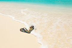 Colored sandals on the beach Stock Image