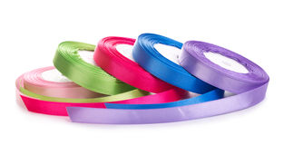 Colored satin ribbons in a roll  Stock Photography