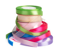 Colored satin ribbons in a roll  Stock Photo