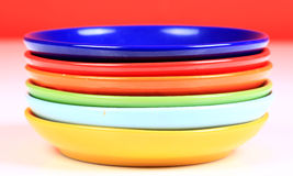 Colored saucers Stock Photos