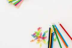 Colored school objects with white background Royalty Free Stock Image