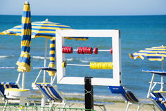 Colored scorekeeper on the beach Royalty Free Stock Image