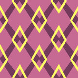 Colored seamless geometric pattern. Ornament of repeating rhombuses. Stock Photo