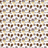 Colored seamless pattern with colorful fruit and chocolate cupca. Kes on a light background Stock Images